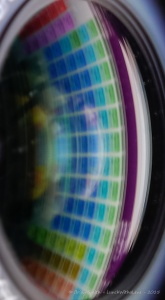 Camera lens with periodic table reflection